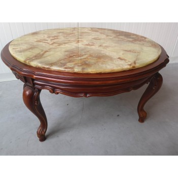 Coffee table with onyx surface
